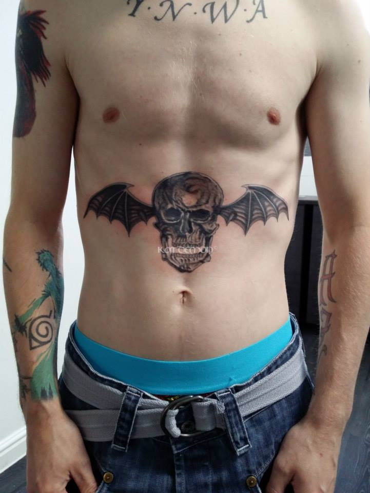 Avenged Sevenfold batwing skull on stomach tattoo